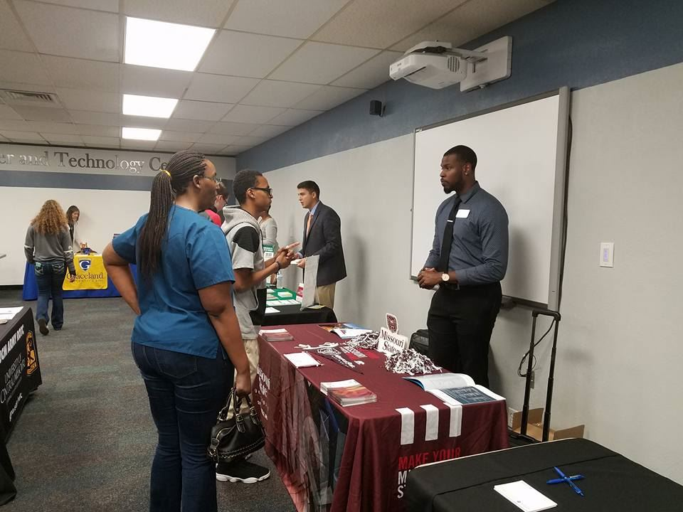 Students talk with a college recruiter at the CTC college fair.