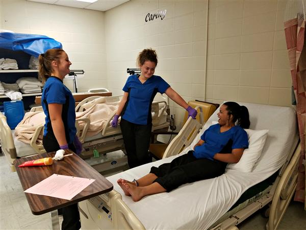 Health science students cover hygiene procedures.