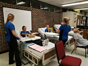 Health Science students learning hygiene care