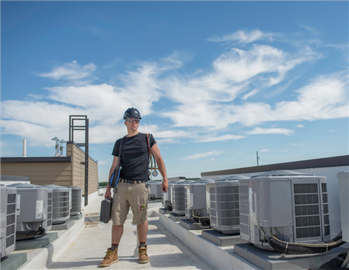 HVAC professional on roof